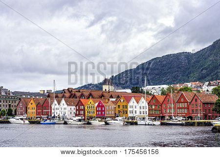 Bergen, Norway - August 14, 2016: View of the Bryggen district, a series of Hanseatic commercial buildings located in the harbor. Since 1979 is on the UNESCO list for World Cultural Heritage sites