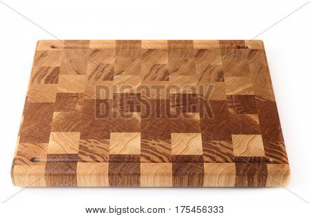 Wooden cutting board isolated on white background with smooth shadows