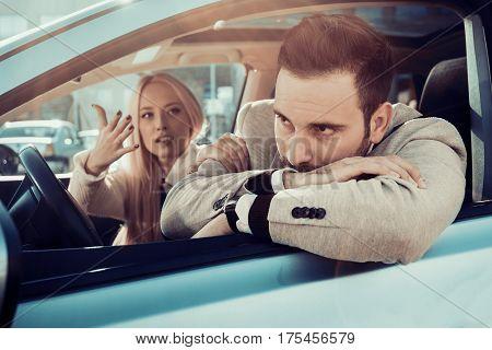 Dangerous city traffic situation, man driving a car