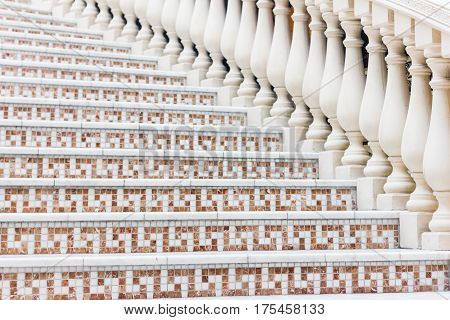 White Stairs With Mosaic Tile With Balusters. Abstract Classical Architecture Interior Fragment