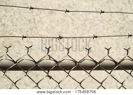 fence and concrete barbed wire metal obstacle barricade