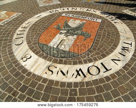 Cobblestone walkway with impressive mosaic in the old town of Klagenfurt, Austria