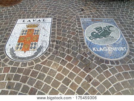 Stunning mosaic decorations on the cobblestone walkway, the old town of Klagenfurt, Austria