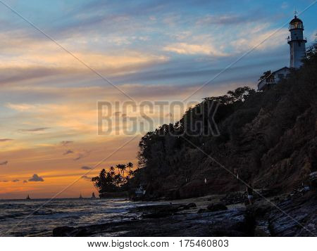 sunset at the diamondhead lighthouse from the beach