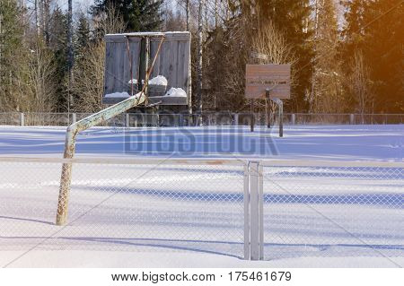 the old basketball court in the winter in the snow.