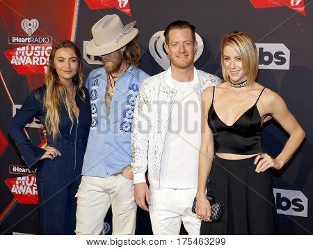 Hayley Stommel, Brittney Marie Cole, Brian Kelley and Tyler Hubbard of Florida Georgia Line at the 2017 iHeartRadio Music Awards held at the Forum in Inglewood, USA on March 5, 2017.