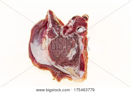 The raw lamb slices closeup. Australian lamb . Part of the carcass of a sheep saddle on the bone. Fresh meat with streaks of fat