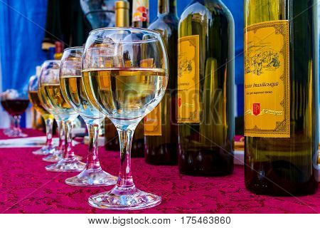Berehove Ukraine - March 3 2017: Glasses with varieties of white wines on the counter on the opening day of the 14th International Wine Festival.