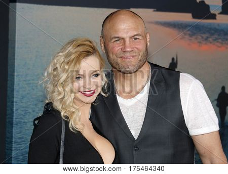 Randy Couture and Mindy Robinson at the Los Angeles premiere of 'Kong: Skull Island' held at the El Capitan Theatre in Hollywood, USA on March 8, 2017.