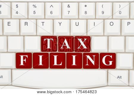 Filing your taxes online A close-up of a keyboard with red highlighted text Tax Filing, 3D Illustration