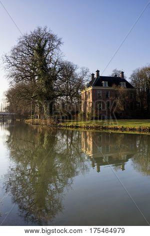 Rhijnauwen castle on the banks of the river Kromme Rijn near Bunnik