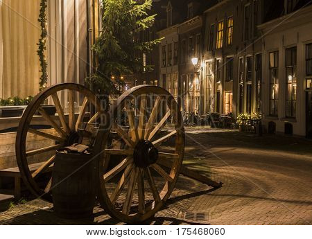 Deventer The Netherlands - December 17 2016: Deventer during Christmas time in the evening with christmas lights carriage and lanterns during Dickens Festival.