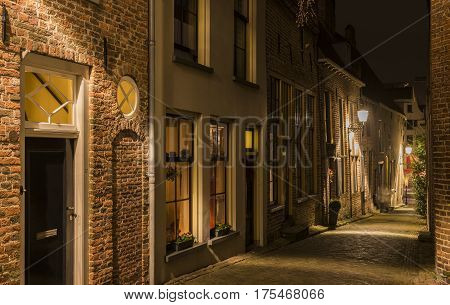 Deventer The Netherlands - December 17 2016: Bergkerkplein (street) in Deventer during Christmas time in the evening with christmas lights and lanterns during Dickens Festival.