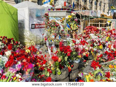 Kiev Ukraine - February 26 2014: Barricade with flowers in Kiev on Maidan Square during the revolution in the Ukraine.