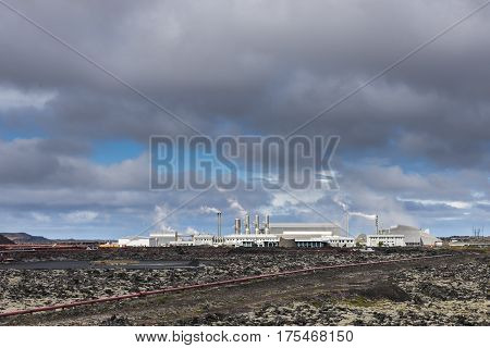 Geothermal plant on Iceland near Blue Lagoon with pipes steam and factory.