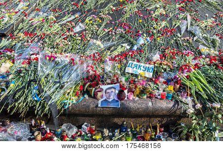 Kiev Ukraine - February 26 2014: Flowers and photo in Kiev on Maidan Square during the revolution in the Ukraine.