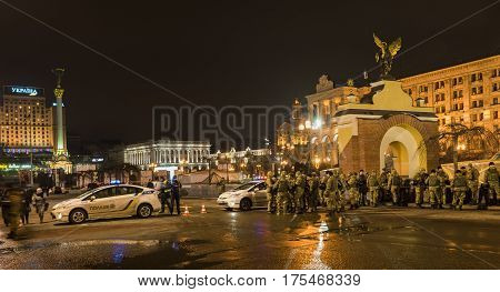 Kiev Ukraine - February 19 2017: Police cars at the commemoration of Maidan revolution in Kiev with big photos of the fallen soldiers of the war.