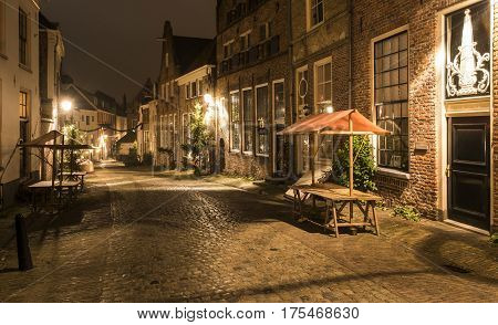 Deventer The Netherlands - December 17 2016: Deventer during Christmas time in the evening with christmas lights and lanterns during Dickens Festival.