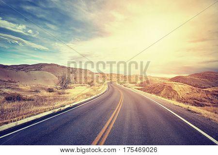 Vintage Toned Scenic Desert Highway At Sunset.