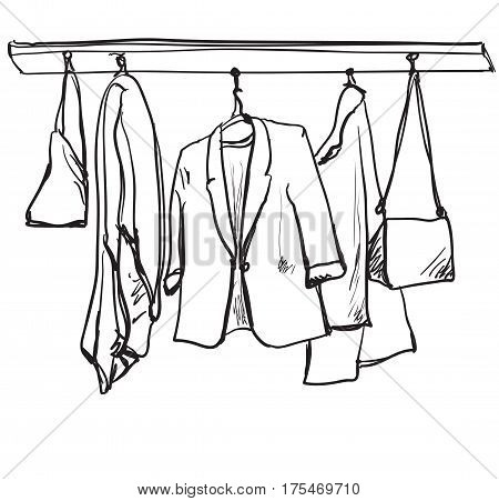 Hand drawn illustration sketch. Fashionable clothes on hangers on white background.