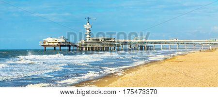 North Sea beach and Scheveningen Pier near Hague, Holland, Netherlands banner panoramic