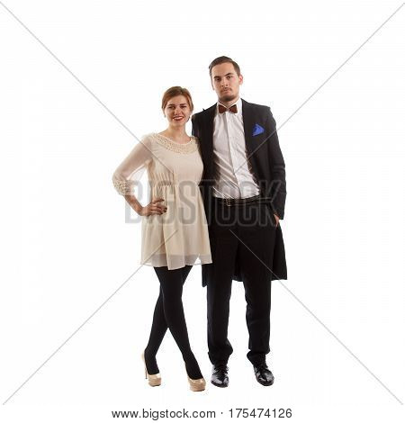 A couple of young adults wearing fancy clothing