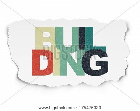Building construction concept: Painted multicolor text Building on Torn Paper background