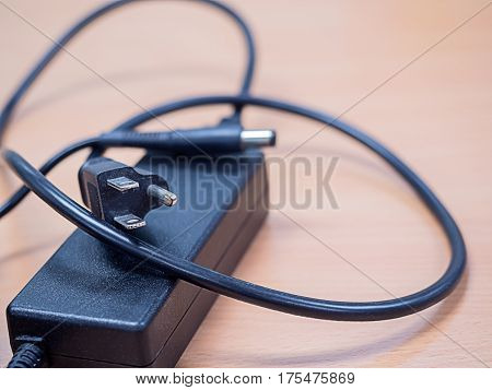 laptop adapter isolated on top table selective focus