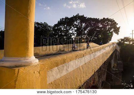 Sancti Spiritus, Cuba on December 31, 2015: Old yellow bridge in afternoon light
