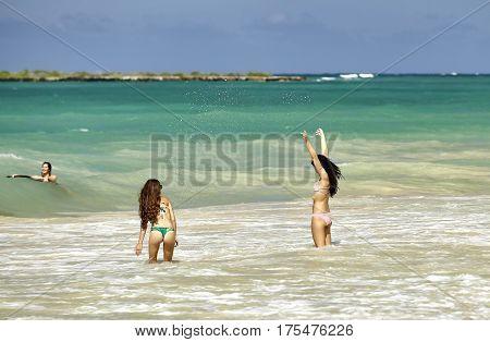 Kailua Hawaii USA - August 1 2026: Young women play on the shores of Kailua Beach