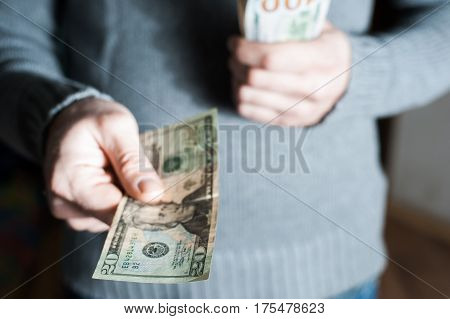 Man Giving Us Dollar Banknote And Holding Cash In Hands.