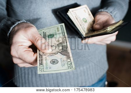 People, Business, Finances And Money Concept - Close Up Of Businessman Hands Holding Open Holding Wa