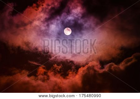The moon on the dark sky among the clouds, natural abstract background