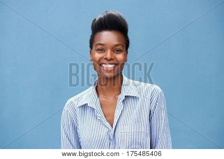 Beautiful Young Black Woman Smiling Against Blue Background