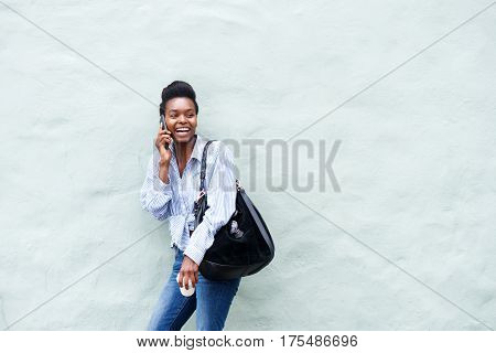 Young Black Woman Laughing And Talking On Cellphone
