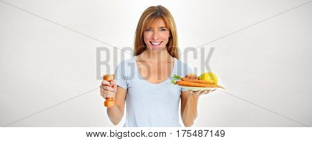 Beautiful lady with dumbbell and food