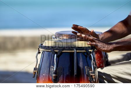 Tropical Island Conga Player closeup of hands