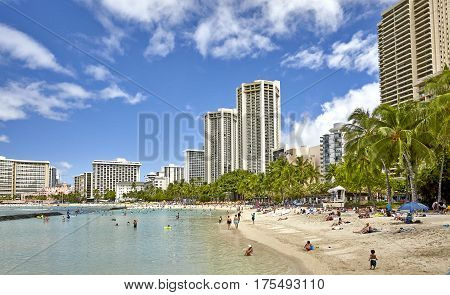 Waikiki Beach, Hawaii, USA -- August 2, 2016: Tourists and locals enjoy the beach at Waikiki, Hawaii