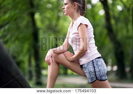 Beautiful Female Jogger Stretching