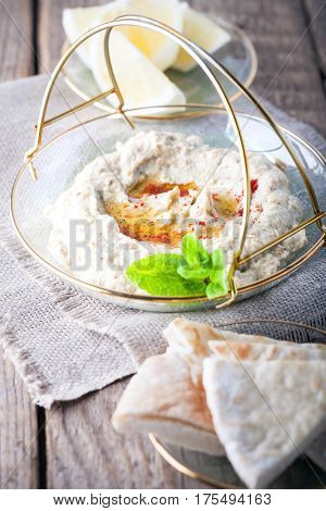 Baba ghanoush, eggplant dip, mediterranean food on a wooden surface