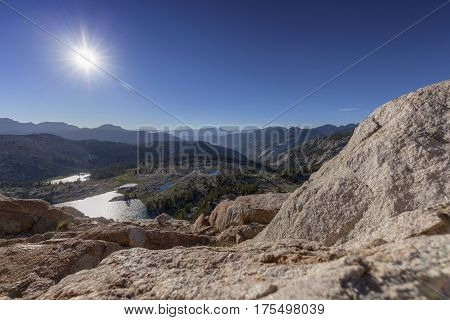 Hot Sun Over Sierra Nevada Mountains - The summer sun burns bright over the Sierra Nevada mountains in California.