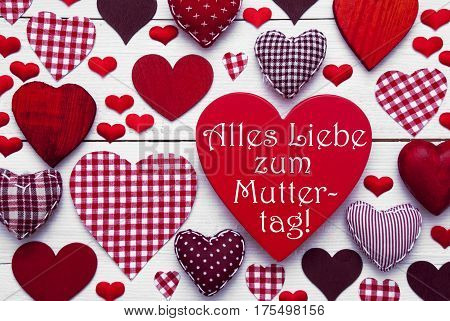 Red Heart Texture With German Text Alles Liebe Zum Muttertag Means Happy Mothers Day. White Wooden Background. Textile Hearts Which Are Dotted and Striped. Greeting Card