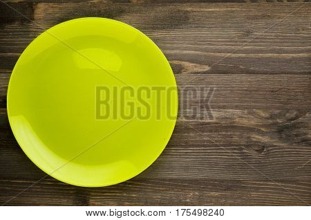 Plate On A Wooden Background.green Plate . Plate Top View. Copy Space