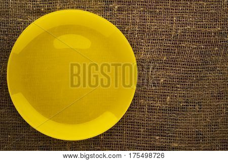Plate On A Wooden Background.yellow Plate . Plate Top View. Copy Space