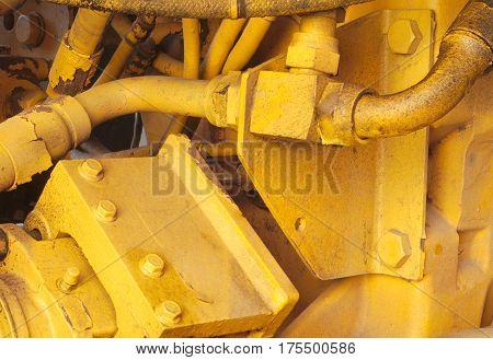 yellow motor engine machine excavator hydraulic tractor vehicle closeup