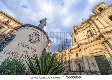 Cardinal Giuseppe Dusmet statue and Saint Francis Church in Catania Sicily Italy