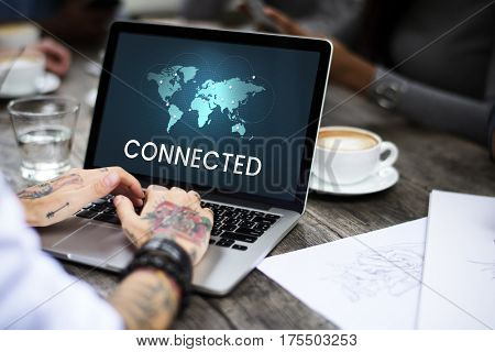 Graphic of global communication connected online community on laptop