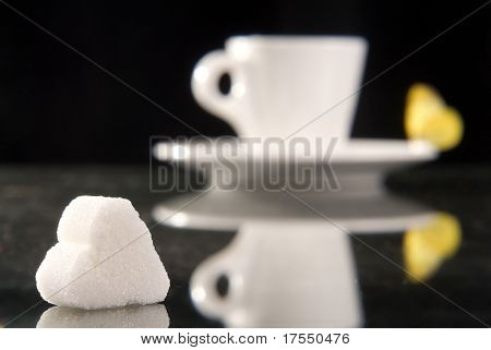 Cups of coffe on black background with reflection