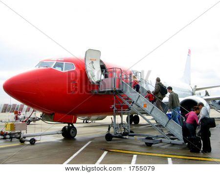 Passengers Boarding A Jetplane