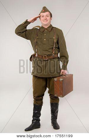 Soldier in historical soviet military uniform of World War II poster